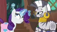 Rarity applying drops to her ears S8E11