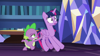 Spike pushing Twilight out the library S7E22