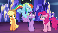 Rainbow Dash holding one of Twilight's wings S7E26