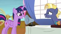 Twilight Sparkle smiles nervously at Star Tracker S7E22