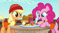 Applejack and Pinkie marveling at snacks S6E22.png