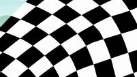 Checkered flag waves in front of camera S6E14