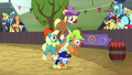 Clown jumps through ring of other rodeo clowns S5E6.png