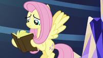 Fluttershy looks through the last book in the library S7E20