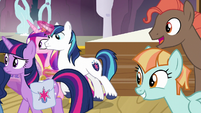 Background ponies look at Twilight and her family S7E22