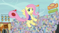 Fluttershy holding a ball with her tail S9E6
