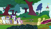 Sweetie Belle looks across the nearby bridge S7E6