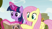 Fluttershy pointing at Appleloosa stadium S9E22