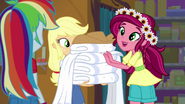 Gloriosa giving towels and dry clothes to Applejack EG4