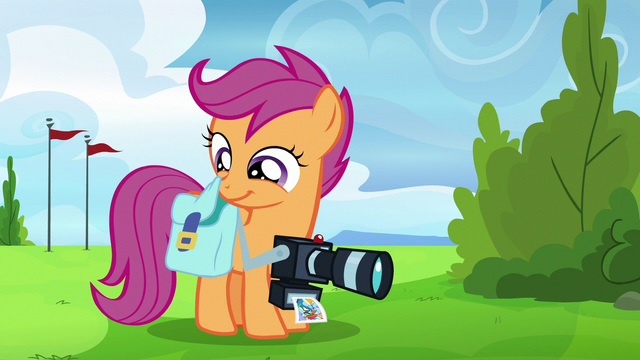 File:Scootaloo takes out her Rainbow Dash scrapbook S7E7.png