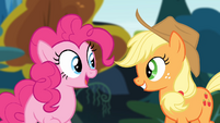 Pinkie and Applejack smiling while looking at each other S4E09