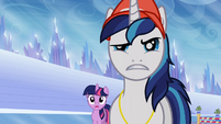 Shining Armor and Twilight Sparkle looking at Ms. Peachbottom S03E12