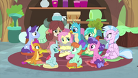 Fluttershy surrounded by students and holding bunnies MLPS3