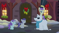 Princess Erroria grabs the hat of a snowpony S06E08