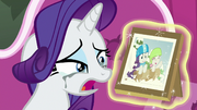 Rarity tearfully looks at sledding photo S7E6