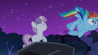 Sweetie Belle pushes Rainbow Dash off rock S3E6