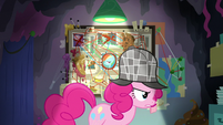 Pinkie Pie crosses in front of her theory board S7E23