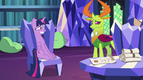 Twilight sitting awkwardly in her study chair S7E15