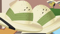 Close-up of Rainbow and Quibble's pith helmets S6E13