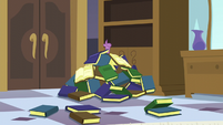 Spike stuck under the book pile S5E10