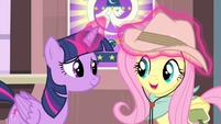 Twilight adjusting Fluttershy's hat S4E11