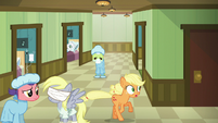 Applejack frantically runs up and down the hallway S6E23