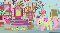Fluttershy leads the ducks past Sugarcube Corner S1E05