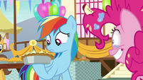 Rainbow Dash looks at the pie in her hoof S7E23