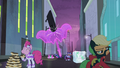 Rarity forming an umbrella shielding herself from the falling neon sign S4E06.png