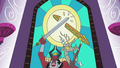 Stained glass window showing Tirek and Discord holding a sword and a sandwich respectively S4E26.png