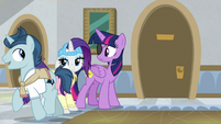 Student 1 walking past Twilight and Rarity S8E16