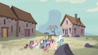 Unmarked villagers race toward the vault S5E2