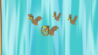 Ducks flying in front of waterfall S4E09