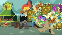 Filthy Rich holding a lot of flowers S7E19