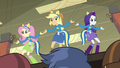 Fluttershy, Applejack, and Rarity on top of lunch table EG.png