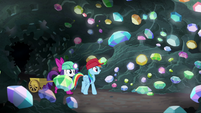 Rarity and Rainbow enter a cave of gems S8E17
