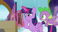 Twilight Sparkle looking at the photo S9E5