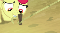 Apple Bloom ties rope around the stake S9E10