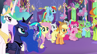 Ponies, changelings, and princesses looking at Twilight S7E1