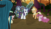 Queen Chrysalis looking at her minions S8E13