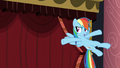 Rainbow in front of curtain S5E15.png