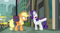 Rarity in shock and pointing her hoof S5E16