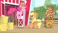 Applejack looks at Pinkie jumping S1E25.png
