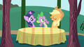 Applejack seats Twilight and Spike at a table S1E01.png