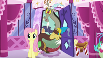 Discord with Fluttershy at the boutique entrance S5E22