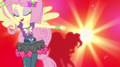 Fluttershy dancing against red background EGS1.png