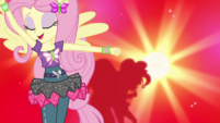 Fluttershy dancing against red background EGS1
