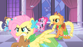 Fluttershy holding a squirrel in her mouth S1E26.png