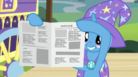 Trixie revealing a reassembled newspaper S7E24