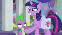 Twilight brushing dust off of Spike S8E25